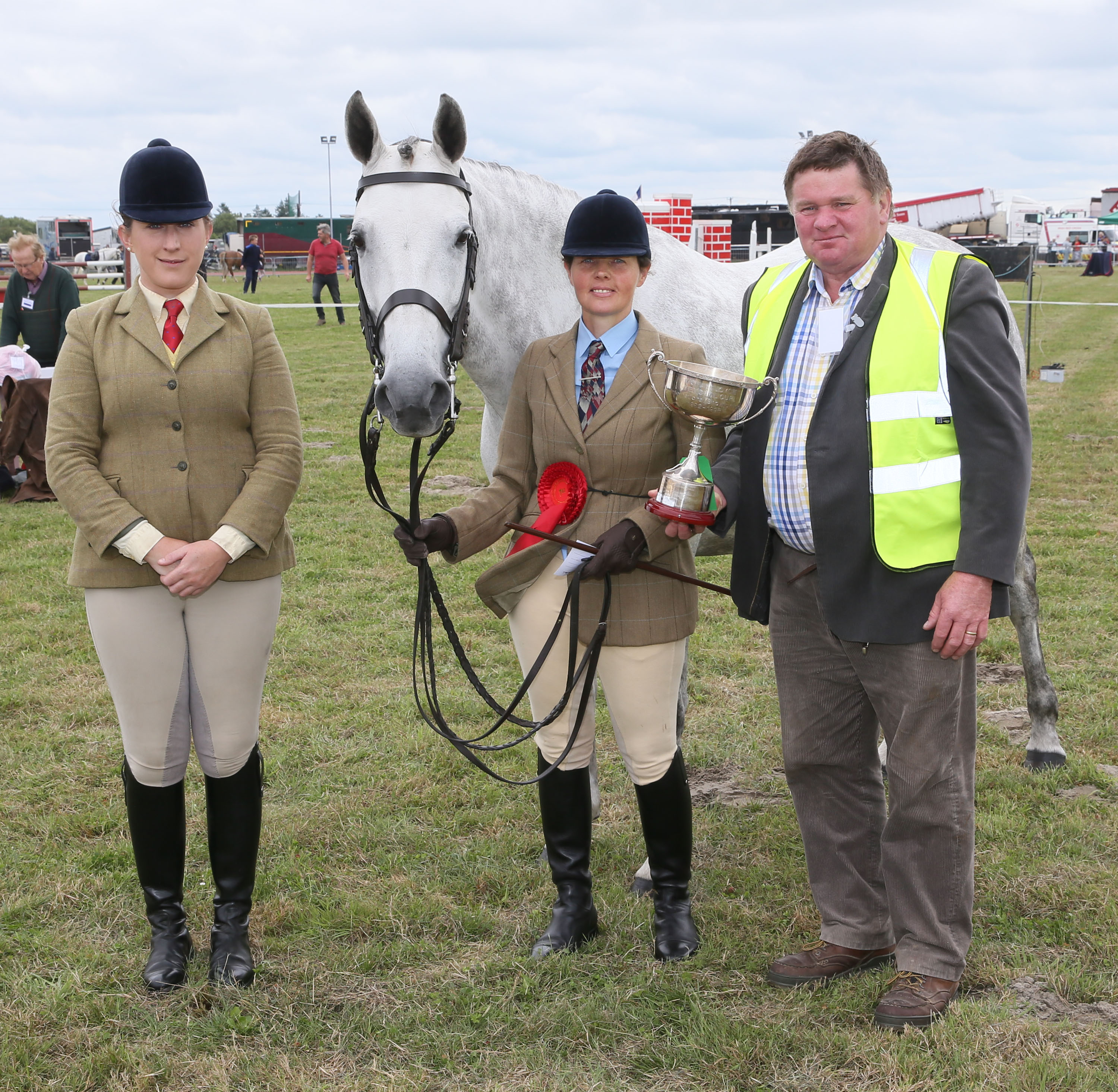 Pat Prendergast presenting the James Prendergast Memorial Cup (sponsored by Pat and Pauline Prendergast) to Petra Hewer, Derrada Westport, for Best Thoroughbred Brood Mare likely to produce a sports Horse, at Claremorris 100th Agricultural Show 2018 with Sarah Conway (Judge) on left. Photo © Michael Donnelly