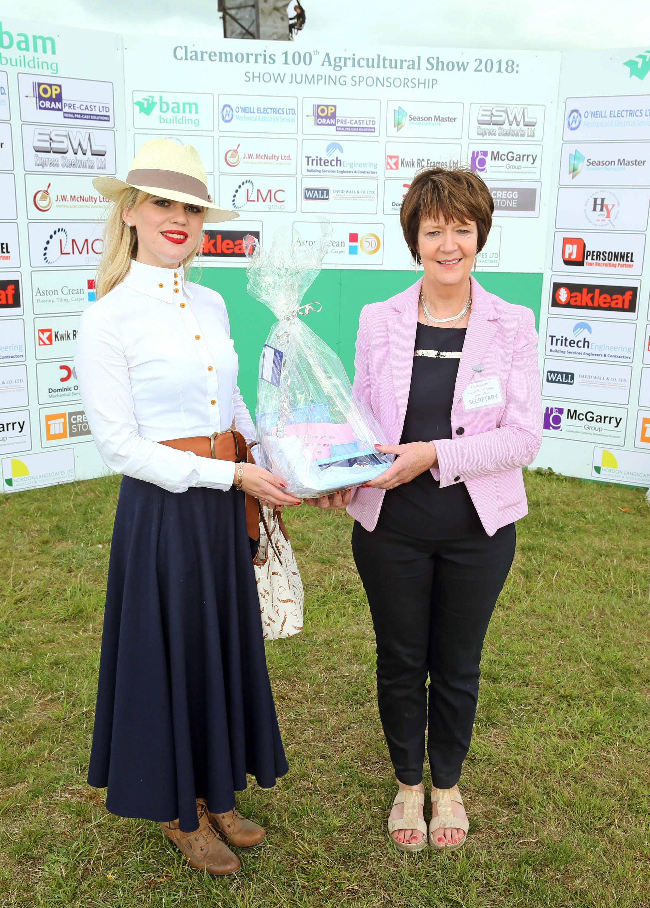 "Maureen Finnerty, secretary Claremorris Agricultural Show  presents Danielle Gingell,  Claremorris, the ""Best Dressed Lady"" competition winner with her prize sponsored by Dylan Jewellers at Claremorris 100th Agricultural Show 2018. Photo © Michael Donnelly"