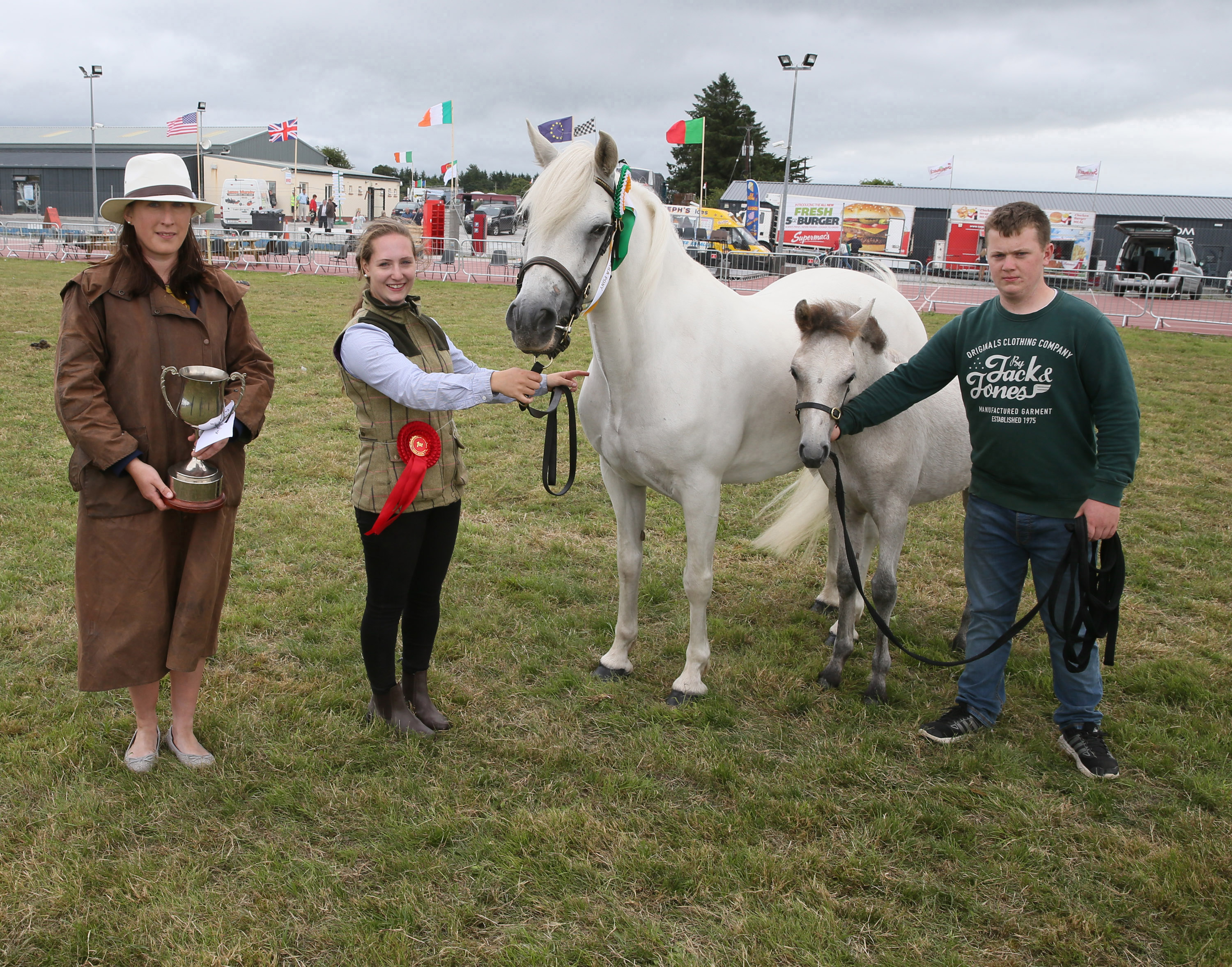 Sarah Conway, (Judge Horse Classes) with the Josie Kerin's Perpetual Cup for Champion Connemara of Show  (sponsored by Ballyhaunis Plant Hire) pictured with Rachel Byrne (granddaughter of Jarlath Grogan, Bekan Claremorris) and Mark Byrne, Tuam. Photo © Michael Donnelly
