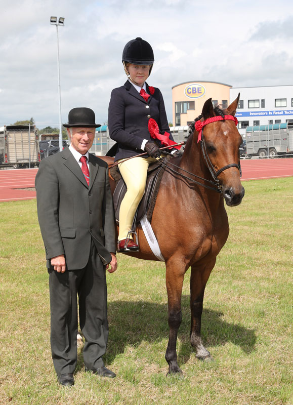 Erin Sheridan, Bundoran winner in  Class  29 (Open Show Pony 138cms) at Claremorris 101st Agricultural Show 2019  pictured with Tony Ennis (Judge). Photo © Michael Donnelly