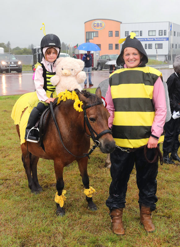 Ellen and Sarah Ryan Claremorris  braving the rain to win in the Fancy Dress Pony Competition at Claremorris 101st Agricultural Show 2019. Photo © Michael Donnelly