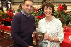 Eamonn McCormack Strokestown, Co Roscommon is presented with the Tom McMahon Memorial Cup (Perpetual) by Maureen Finnerty, Secretary, Claremorris Agricultural Show for largest number of 1st prizes in Flower section. Photo © Michael Donnelly