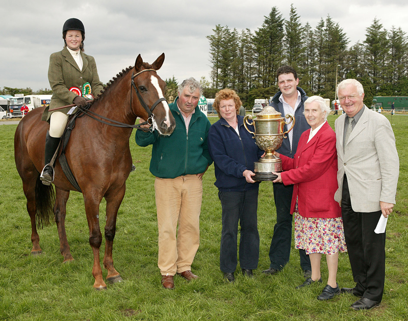 "The Oliver Dixon Gold Cup for ""The Champion Hunter  of Claremorris Show  under saddle"" was ""Ginger Holly"" ridden by Annette Walsh McMullen, Ballina, pictured at the presentation from left Tony and Irene Walsh James McMullen, Poppy Dixon, and Cormac Hanley PRO. Photo Michael Donnelly"