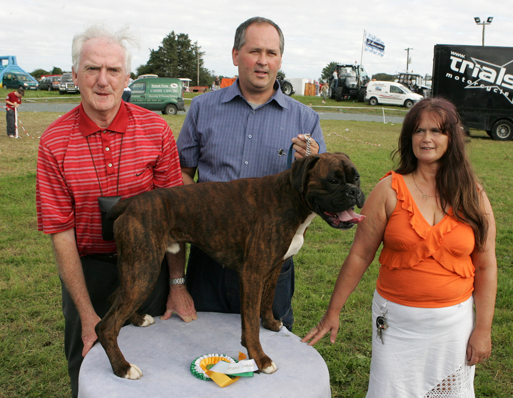 "Evans Boland, from Aclare Co Sligo with ""Tyson"",  Reserve Champion Dog at the 88th Claremorris Agricultural Show, included on left is Johnny Farragher Steward and Marie Mullen, Roscommon, (judge). Photo: © Michael Donnelly."