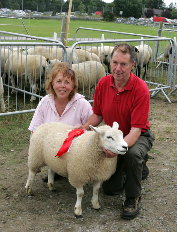 "Mary and Michael Bryce, Ballycastle pictured with their 1st Prize winning Lamb in the ""Best Factory Lamb""  class, sponsored by O'Brien's Pharmacy at the 88th Claremorris Agricultural Show. Photo: © Michael Donnelly"