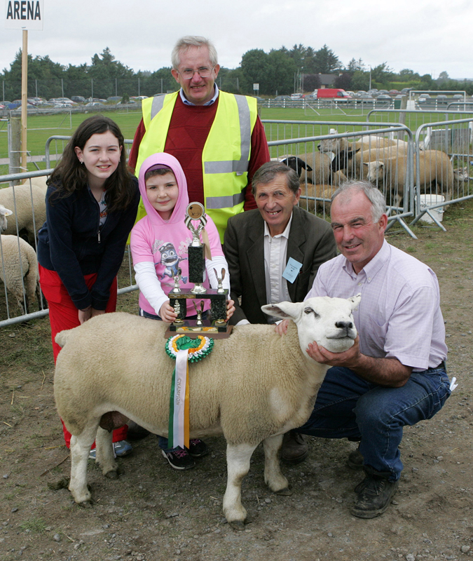 Michael Murphy Moneen, Cummer, Tuam (on right) is presented with the Walter Brennan  Perpetual trophy for Overall Champion Sheep at the 88th Claremorris Agricultural Show, included in photo from left: Michelle Murphy, Laura Murphy, John McWalter, Sheep Steward (at back), and Patsy Reilly (Sheep Judge). Photo: © Michael Donnelly