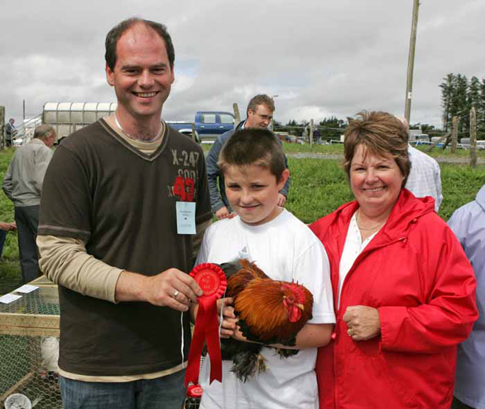 Daragh Sheridan, Tonacrick, Lahardane pictured with his prizewinning Partridge Pekin.  Included in photo are Ian Satchwell, Roscommon (judge), and Eileen Sheridan. Photo: © Michael