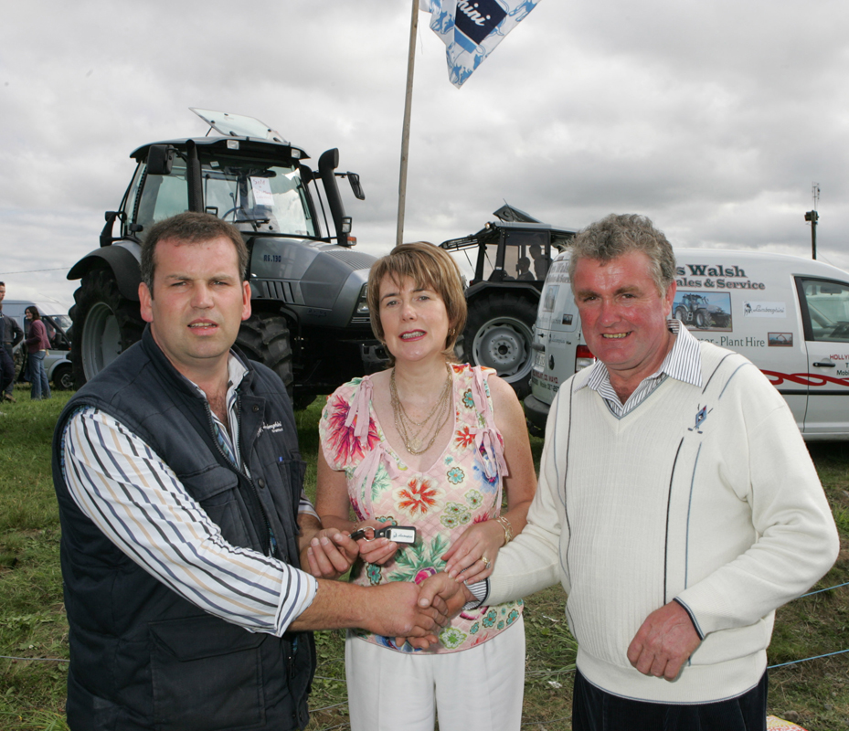 Des Walsh of Agri Sales, Hollymount presents the keys of new Lamborghini tractor to Mary and Pat Coleman, Brookhill Claremorris at the 88th Claremorris Agricultural Show. Photo: © Michael Donnelly.