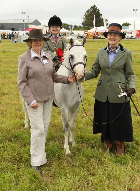 "Carol Ruttle, Ardagh Co Limerick, winner of the ""Lead Rein Class"" at the 94th Claremorris Agricultural Show, led by Joan Ruttle, on right with Ms Patricia Byrne, (Judge) Ballymoreustace Co Kildare (on left). Photo: © Michael Donnelly Mayopics Photography"