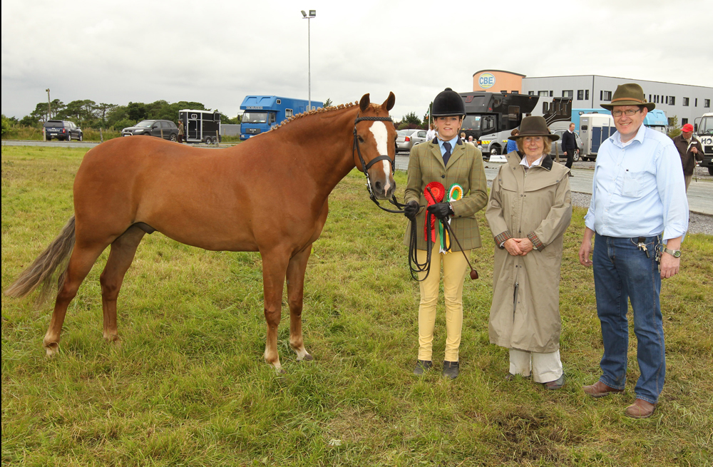 "Jane Hennigan, Claremorris pictured with her ""Champion in Hand"" pony of  the 94th Claremorris Agricultural Show include in photo are  Pat Byrne, Ballymoreustace Co Kildare (Judge) and Tom Byrne Chairman of Show. Photo: © Michael Donnelly Photography"