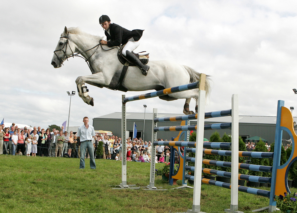 Damien Griffin, Ahascragh Ballinasloe on Lissyegan Clover Diamond clears the huge 6ft 10 inch  jump to win the high jump competition at the 88th Claremorris Agricultural show. Photo: Michael Donnelly