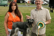 "Stephen Loughney, Ballina with ""Phil"" Champion Dog (Miniature Schnauzer) at the 88th Claremorris Agricultural Show, included on left is Marie Mullen, Roscommon, (judge). Photo: © Michael Donnelly"