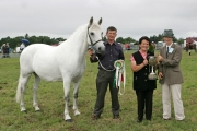 Breda Horan, Castlegar, Galway is presented with the cup for Champion Connemara by Sarah Jacob (judge), at the 88th Claremorris Agricultural Show, Roger Brady shows the champion Pony. Photo: © Michael Donnelly