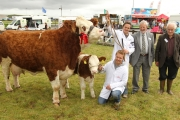 The Neenan Bros, Ballyhaunis winners in the Western Simmental Club  Cow in calf or in Milk Class at the 94th Claremorris Agricultural Show, pictured with Seamus Aherne Limerick, (Judge) and Paddy Veldon, vice-president Claremorris Show). Photo: © Michael Donnelly